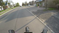 4k gopro pov hooligan jumps his motorcycle on street Stock Footage