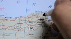 Tunis,Tunisia, Europe. Man marking a cities on world map Stock Footage
