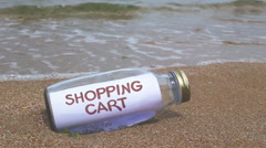 Add to shopping cart concept written on a message washed ashore Stock Footage