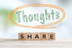 Share your thoughts sign on a desk Stock Photos