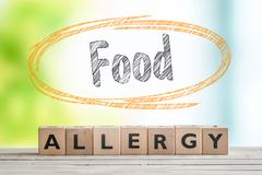 Food allergy sign on a table Stock Photos