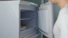 Man takes chicken meat from refrigerator Stock Footage