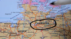 Hamburg, Germany, Europe. Man marking a cities on world map Stock Footage
