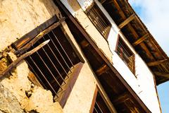Old dilapidated rustic building facade Stock Photos