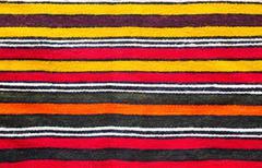 Multicolored handmade woollen rug texture Stock Photos