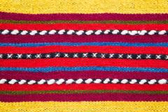 Bulgarian hand woven woollen rug in a bright striped pattern - stock photo
