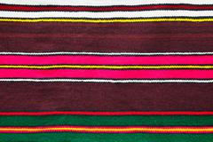 Handmade woollen rug with colorful stripes - stock photo