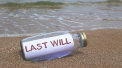 Last will written on a message washed ashore Stock Footage