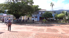 People Walk Towards The Park Central The Centre Of Trujillo Town Honduras 4K Stock Footage