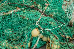 Messy green fishing net Stock Photos