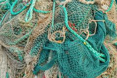 Fishing net by a harbor - stock photo