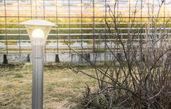 Lamp outside af greenhouse Stock Photos