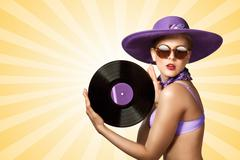 Bikini and vinyl. Stock Photos