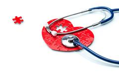 Heart disease, puzzle heart with stethoscope - stock illustration