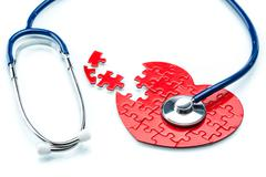 Heart disease, puzzle heart with stethoscope Stock Illustration
