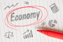 Economy drawing on linear paper Stock Photos