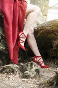 closeup of womans legs with red high heels - stock photo