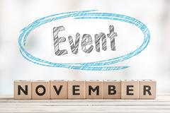 November event sign with wooden blocks - stock photo