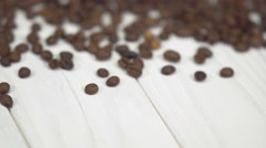 Coffee Beans On A White Wooden Table. Stock Footage