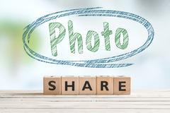 Share photo sign on a desk Stock Photos