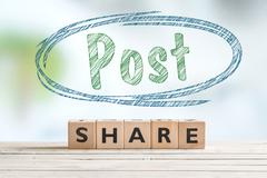 Post share sign on a table - stock photo