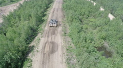 Flying over the tank in rough wooded country Stock Footage