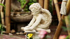 View of the exterior of a contemporary garden. The garden sculpture of angel. Stock Footage