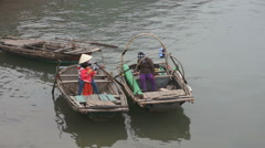 Local people in their boats in the harbor, Cat Ba Island, Halong Bay, Vietnam Stock Footage