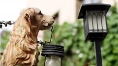 The exterior of a contemporary garden. The garden sculpture of dog with lantern. Stock Footage