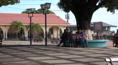 Local Family Sits Under A Shade Tree In Trujillo, Honduras 4K UHD Stock Footage