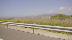 Safety barrier at the side of a rural road Stock Footage