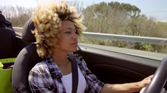 A Young Black Woman Driving A Cabriolet In Summer Stock Footage