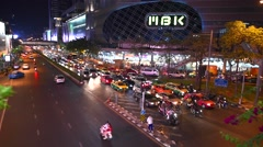 Traffic on street and MBK Center Bangkok Stock Footage