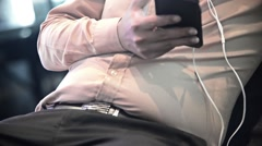 Unknown Fat  Asian male use smartphone Stock Footage