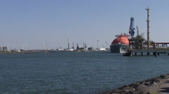 LNG tanker Arctic Voyager at Gas terminal Rotterdam - wide shot Stock Footage