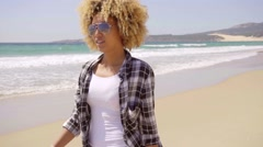 Afro-American Woman Walks Beach Along - stock footage