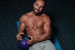 Abdominal Exercises With Kettlebell Bodybuilding Training Stock Photos