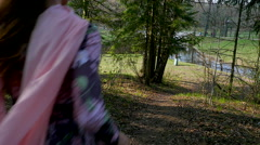 Beautiful girl walking in a spring Park.slow motion Stock Footage