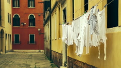 Drying laundry waving at the old italian street, Venice. Stock Footage