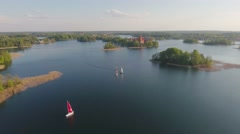 Lithuania, Trakai castle and lake aerial view on sunset. Stock Footage