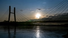 The movement of the sun over the suspension bridge in Warsaw Stock Footage