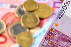 euro banknotes, coins - stock photo