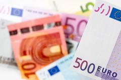 euro banknotes, coins - stock photo