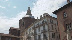 Pavia Cathedral seen from Piazza Vittoria, panoramic shot Stock Footage