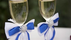 Glasses with Champagne, wedding, newlyweds - stock footage