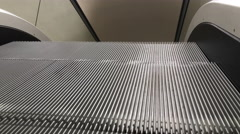 Repetitive pattern of escalator steps in motion 4k Stock Footage