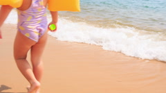 Closeup Back Little Girl in Safety Armbands Goes to Sea Stock Footage