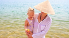 Closeup Mother Holds in Arms Small Daughter Stock Footage