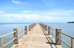 Cement bridge road in a sea like direction way to success target Stock Photos