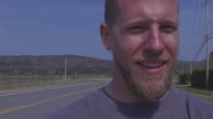 Manly guy with beard walking in slow motion Stock Footage